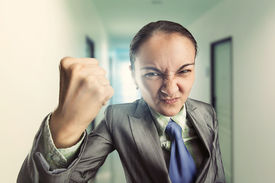 stock photo of irritated  - Angry irritated woman in the office - JPG