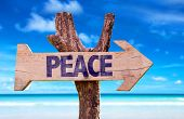 foto of peace-sign  - Peace sign with a beach on background - JPG
