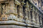 image of tamil  - Hindu God statue on a wall in Hindu Brihadeeswarar Temple Thanjavur Tamil Nadu India - JPG