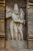 picture of tamil  - Hindu God statue on a wall in Hindu Brihadeeswarar Temple Thanjavur Tamil Nadu India - JPG