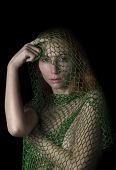 image of caught  - woman posing caught in the net and thinking on black background - JPG