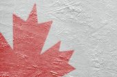 image of hockey arena  - Fragment of the image of the Canadian flag on a hockey rink - JPG