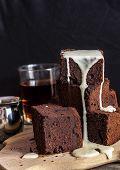image of brownie  - chocolate brownie with dark beer on a black background - JPG