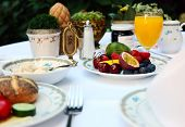 image of continental food  - Outdoor continental breakfast at hotel - JPG