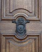 stock photo of lions-head  - Lion head knocker and vintage wooden door detail - JPG