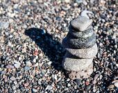 image of fulcrum  - Stack of round smooth stones on a seashore - JPG