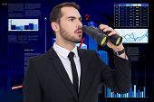 picture of binoculars  - Surprised businessman standing and holding binoculars against business interface with graphs and data - JPG