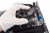 stock photo of cpu  - Installing CPU cooler on modern PC computer motherboard - JPG