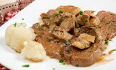 stock photo of veal  - scallops of veal with porcini mushroom sauce and parsley - JPG