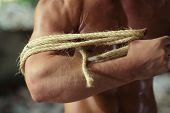 foto of seminude  - young guy pulls rope on hand in abandoned building - JPG