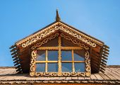 image of attic  - Attic window of an old wooden house decorated with wood carvings - JPG