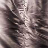 picture of down jacket  - Creased down jacket fragment as a background texture composition - JPG