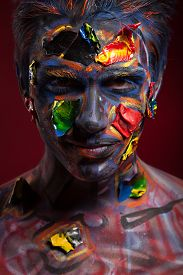 foto of mauri  - A creepy portrait of a pierced halloween moor with bloody body art - JPG