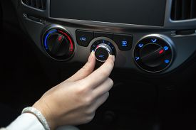 picture of designated driver  - Woman turning on car air conditioning system  - JPG