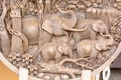 foto of chisel  - Wood carving is a form of working wood by means of a cutting tool in one hand or a chisel by two hands or with one hand on a chisel and one hand on a mallet - JPG