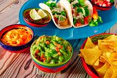 picture of nachos  - Fish tacos mexican food with guacamole nachos and chili pepper sauce - JPG