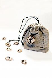 stock photo of rune  - Scandinavian runes of moose horns in linen fabric bags - JPG