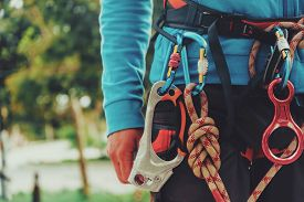 picture of extreme close-up  - Rock climber wearing safety harness and climbing equipment outdoor close - JPG