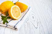 Juicy Lemons With Leaves Mint On A White Wooden Background. Lemon Slices. Fresh Lemon. Fresh Citrus poster