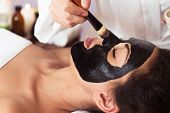 Prettyl Woman With Facial Mask At Beauty Salon. Spa Treatment poster