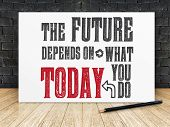 Inspiration Quote : the Future Depend On What You Do Today On White Frame In Black Brick Wall And poster