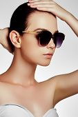 Fashion Sunglasses. Sexy Woman In Swimsuit With Golden Sunglasses And Natural Makeup. Glamour Shot O poster