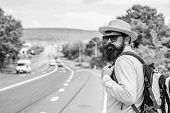 Man At Edge Of Highway Wait Transport. Travel Alone. Hitchhiking Means Transportation Gained Asking  poster