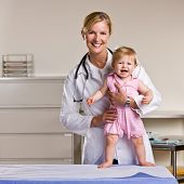 picture of doctors office  - Doctor and baby girl in doctor office - JPG