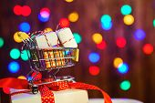 Shopping Cart With Christmas Box. Valentines Gifts. Color Bokeh Background. Christmas Sales. Merry  poster