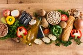 Healthy Eating. Mediterranean Diet. Fruit,vegetables, Grain, Nuts Olive Oil And Fish On Wooden Table poster