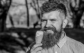 Man With Long Beard Enjoy Ice Cream, Close Up. Chilling Concept. Man With Beard And Mustache On Happ poster