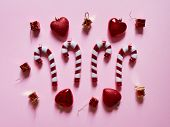 Christmas Candy Cane Drums Hearts And Gifts At Studio Above View Over A Pink Background Isolated Fla poster