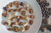 Almonds, Hazelnuts, Walnuts, Cashew Nuts On A White Plate, Three Whole Walnuts, Crunchy Whole Grain poster