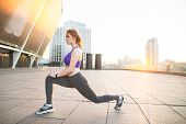Sports Girl Doing Stretching, Warming Up Before Training. Fitness Girl In Sports Wear Stretches On T poster