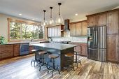 Luxurious Open Plan Kitchen Design With Large Center Island poster