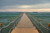 View At The Wooden Pier In The Red At Sunset. Clear Sea With Turquoise Water. Summer Vacation At A S poster
