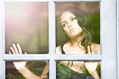 stock photo of snob  - portrait of a beautiful fashion looking out the window - JPG