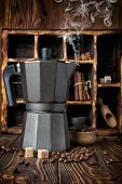 Steaming Geyser Coffee Maker And Roasted Beans With Wooden Box On Rustic Background poster