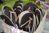 Group of beach sandals for sale poster