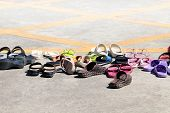 Sandals Shoes Many Heap On Ground, Lots Of Pile Sandals Shoes Rubber, Sandals Shoes, Heap Casual Sho poster
