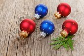 picture of shaky  - Christmas balls on wooden background with green thuja branch - JPG