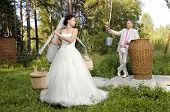 stock photo of yoke  - beautiful fiancee with yoke and bucket wedding humour photo - JPG