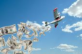 image of hydroplanes  - of hydroplane flying in blue sky rain down very mass dollar banknote - JPG