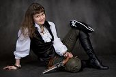 picture of crossed pistols  - Girl on black with pistol and pirate hat - JPG