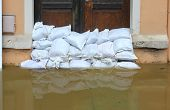 picture of sandbag  - Sandbags stacked in front of a doorway in the old town of Meissen, Saxony, Germany - Flood in June 2013