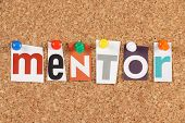 pic of mentoring  - The word Mentor in cut out magazine letters pinned to a cork notice board - JPG