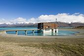 foto of hydro  - The Tekapo B hydro power station on Lake Pukaki, glacier water, low lake level, South Island, New Zealand