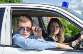 picture of flashers  - Two young detectives driving to crime scene - JPG