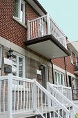 stock photo of duplex  - Attached duplex in a row of community housing - JPG