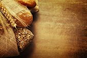 stock photo of sackcloth  - Freshly baked  bread on wooden table - JPG